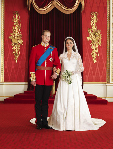 In this photo provided by Clarence House on Saturday April 30 2011, Britain&#39;s Prince William, left, and his wife Kate, Duchess of Cambridge, pose for a photograph in the throne room at Buckingham Palace, following their wedding at Westminster Abbey, London, on Friday, April 29.  <span class=meta>(&#40;AP Photo&#47;Hugo Burnand, Clarence House&#41;)</span>
